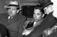 JOHN DILLINGER-Dillinger under heavy guard as he is driven to Indiana. 1-30-34