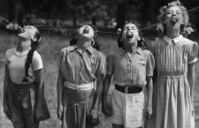 25th July 1952:  Four young dancers of the Italia Conti School compete in a potato eating contest in Green Park, London. They are (L to R) Frances Reynolds of Palmers Green, Sonia Hoey of Hampton Court, Maureen Bullion of Catford and Elizabeth Hewitt of Erith in Kent.  (Photo by Reg Speller/Keystone/Getty Images)