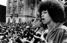 7/4/74--RALEIGH, N.C.: Black activist Angela Davis addresses a rally estimated at 5,000 people who marched through downtown Raleigh to the Capitol Building sponsored by the National Alliance Against Racist and Political Repression in protest of the North Carolina death penality 7/4.
