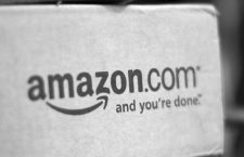 A box from Amazon.com is pictured on the porch of a house in Golden, Colorado in this July 23, 2008 file photo. Amazon.com gave a confident revenue forecast that suggested its aggressive expansion into new businesses is paying off, soothing concerns about its slimmed-down profit margin, according to news reports on April 26, 2011.  REUTERS/Rick Wilking/Files (UNITED STATES - Tags: BUSINESS)