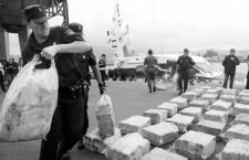 Spanish police unload sacks of cocaine from a Belgian-flagged catamaran, totalling nearly three tonnes, at the port in Vilagarcia de Arousa, northwestern Spain, June 15 2005. Police said two Belgians and an Albanian were arrested on the boat which contained the haul. Police arrested another 11 people in Galicia, northwest Spain, and five in southern Spain. REUTERS/Miguel Vidal