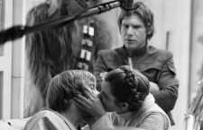 """Princess Leia (Carrie Fisher, right) kisses Luke Skywalker (Mark Hamill) while an indignant Han Solo (Harrison Ford, background) looks on. A new book, """"The Making of 'The Empire Strikes Back: The Definitive Story"""" was released in October 2010.(Courtesy of Lucasfilm/MCT)"""