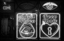General view of neon signs outside a peep show and adult video shop in Soho, central London.