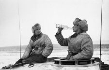 WORLD WAR II: UKRAINE.  Red Army soldiers rest on top of a tank near Kirovograd, Ukraine. Photographed January 1944.