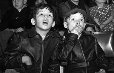 16th December 1954:  Two boys, captivated by the trapeze act at the circus, gaze in awe.  (Photo by Monty Fresco/Topical Press Agency/Getty Images)