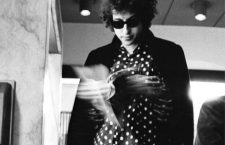 -FILE- U.S. rock singer and poet Bob Dylan leafs through a book at Sandbergs bookstore in Stockholm, Sweden, April 28, 1966. He was  looking for an English translation of the French poet Arthur Rimbaud, without success. Dylan gave one concert at the Concert Hall in Stockholm April 29. Photo Bjorn Larsson Ask / SCANPIX / kod 3022 BETALBILD