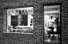 "A delivery driver checks the order before leaving Pizza Land restaurant, which was featured in the television series ""The Sopranos"", as a memorial to deceased actor James Gandolfini is seen in its front window in North Arlington, New Jersey June 20, 2013. Gandolfini, best known for his Emmy-winning role as a mob boss in the ""The Sopranos"", passed away on Wednesday of an apparent heart attack. He was 51.      REUTERS/Carlo Allegri  (UNITED STATES - Tags: ENTERTAINMENT OBITUARY BUSINESS FOOD TPX IMAGES OF THE DAY)CODE: X02452"