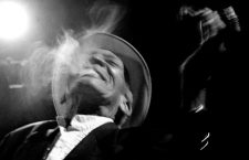 """CAPTION CORRECTION -- CORRECTING AGE Cuban musician Compay Segundo is seen in this file photo smoking a cigar while on stage in Havana, February 28, 2000. Compay Segundo died in Havana early July 14, 2003 at the age of 95 years. Born Francisco Repilado, he obtained his nickname from the slang """"compadre"""" and Segundo for his trademark bass harmony second voice. Compay Segundo was brought to world fame with Ry Cooder's multi-Grammy winning Cuban song collection """"The Buena Vista Social Club."""" PICTURE TAKEN FEBRUARY 28, 2000. REUTERS/Rafael Perez/File"""