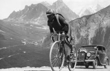 ca. 1935 --- Original caption: Here the Spanish bicycle racer Truerbach is climbing an Alpine road during the Tour de France. --- Image by © Underwood & Underwood/Corbis