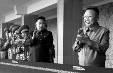 Image #: 12166438    (101010) -- PYONGYANG, Oct. 10, 2010 (Xinhua) -- Kim Jong Il (1st R), top leader of the Democratic People's Republic of Korea (DPRK), and Kim Jong Un (2nd R), vice-chairman of the Central Military Commission of the Workers' Party of Korea (WPK), applaud before a grand military parade to celebrate the 65th anniversary of the founding of the WPK, in Pyongyang, Oct. 10, 2010.       Xinhua /Landov