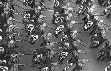 """SA-Aufmarsch mit Hakenkreuzfahnen  und geschulterten Tornistern in den Straßen Nürnbergs während des """"Reichsparteitags der Freiheit"""".  SA marching-up with swastika flags and Tornistern in the roads Nuernbergs geschulterten during the """"realm Party Congress of the liberty"""". * SA-Aufmarsch avec des drapeau et geschulterten Tornistern dans le route Nuremberg pendant """"congrès du parti le liberté""""."""