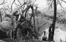 VIETNAM WAR: LAOTIAN BORDER.  A U.S. Marine throws a hand grenade into a Viet Cong spiderhole during a battle near the Laotian border, May 1967.