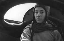 Anne Morrow Lindbergh inside the rear cockpit of the modified Lockheed Sirius during the Arctic air-route survey mission in 1933.