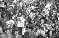 Service men and women send up cheers at news of Japanese capitulation, 9/2/45.