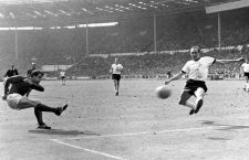 1966 World Cup Final England v West Germany Geoff Hurst lashes the ball past West German goalkeeper Willi Schulz to score England's third goal. In the centre is Franz Beckenbauer. 30th July 1966.